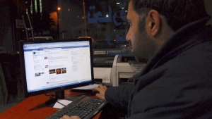 A Syrian man connects on his Facebook account at an internet cafe, in Damascus, Syria, on Tuesday Feb. 8, 2011. (AP / Muzaffar Salman)