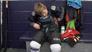 Six-year-old Shane Buchan gets dressed for hockey practice in Oakville, Ont., Friday, Oct.5, 2012. (Richard Buchan / THE CANADIAN PRESS)