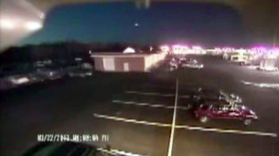 A bright flash of light, top center, streaks across the early-evening sky in what experts say was almost certainly a meteor coming down in Seaford, Del., Friday, March 22, 2013. (Hopkins Automotive Group)