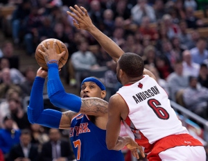 New York Knicks forward Carmelo Anthony, left, pushes off Toronto Raptors forward Alan Anderson during second half NBA basketball action in Toronto on Friday, March 22, 2013. (Nathan Denette / THE CANADIAN PRESS)