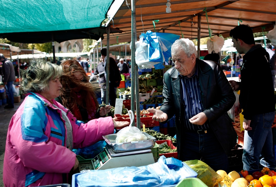 People buy goods from a vegetable market, in central Nicosia, on Saturday, March 23, 2013. (AP / Petros Giannakouris)