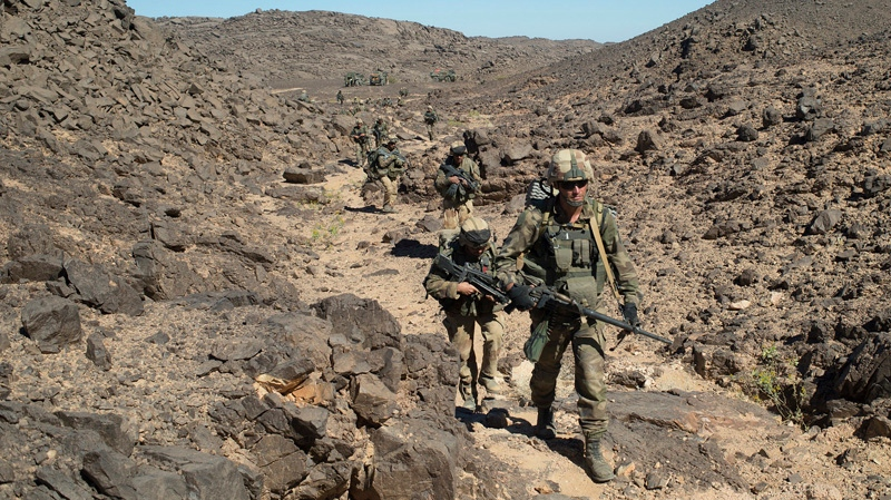 French soldiers are seen patrolling in the Mettatai region in northern Mali on March 8, 2013. (Arnaud Roine / ECPAD)
