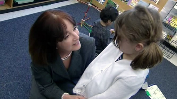 Education Minister Leona Dombrowsky tours a full-day kindergarten class in Toronto, Wednesday, Feb. 9.