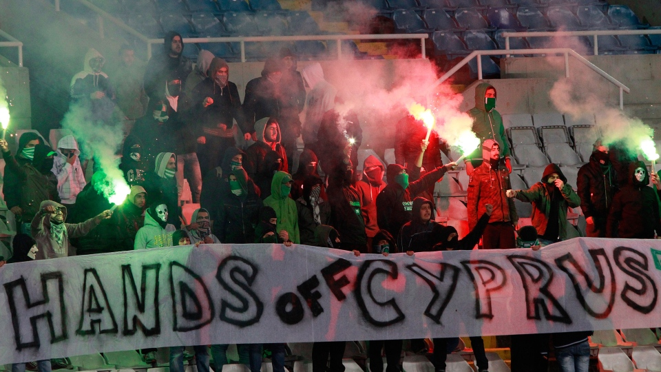Cypriot soccer fans with an anti-bailout protest banner during the group E 2014 World Cup qualifying soccer match between Cyprus and Switzerland at GSP stadium in Nicosia, Cyprus, Saturday, March 23, 2013. (AP / Petros Karadjias)