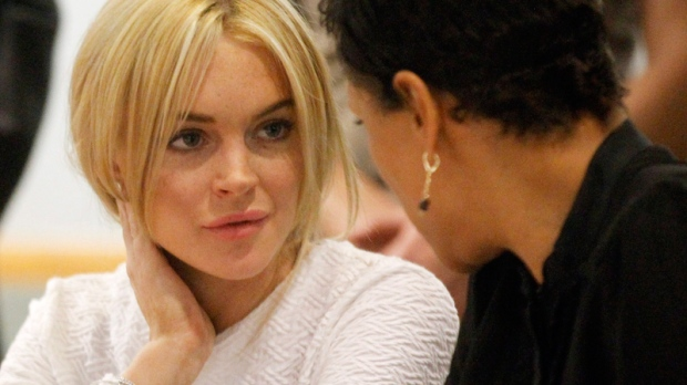 Lindsay Lohan appears in court during her arraignment on a felony grand theft charge with her lawyer Shawn Chapman Holley at the LAX Airport Courthouse in Los Angeles, Wednesday, Feb. 9, 2011. (AP / Mario Anzuoni)