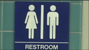 A restroom sign is seen in this file photo. Ten states sued the federal government Friday over rules requiring public schools to allow transgender students to use restrooms conforming to their gender identity.