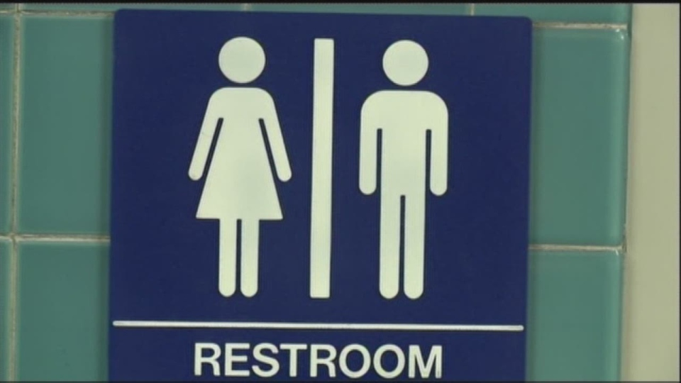 A bathroom sign shows the symbols for women and men. A group of activists is taking their fight to remove gender from birth certificates to the B.C. Human Rights Tribunal.