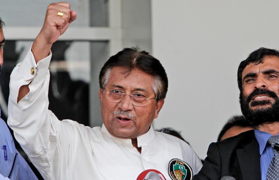 Former Pakistani President Pervez Musharraf, gestures upon his arrival to the Karachi airport, Pakistan, Sunday, March 24, 2013.  (AP / Shakil Adil)
