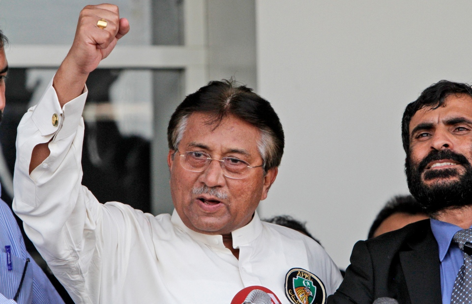 Former Pakistani President Pervez Musharraf, gestures upon his arrival to the Karachi airport, Pakistan, Sunday, March 24, 2013.  (AP / Shakil Adil)