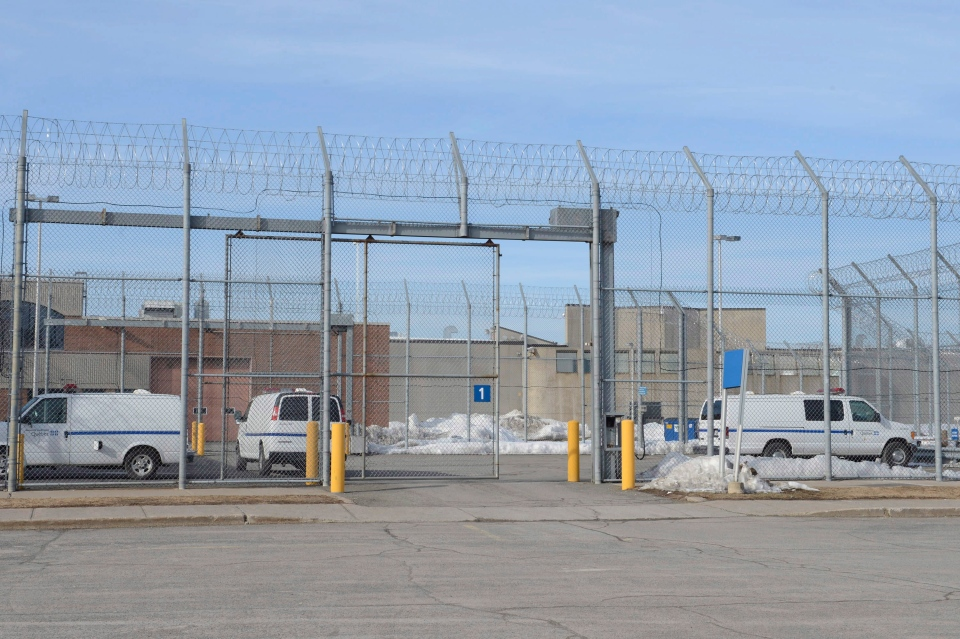 Vehicles move inside the prison in Saint-Jerome, Que., Monday, March 18, 2013.  (Ryan Remiorz / THE CANADIAN PRESS)