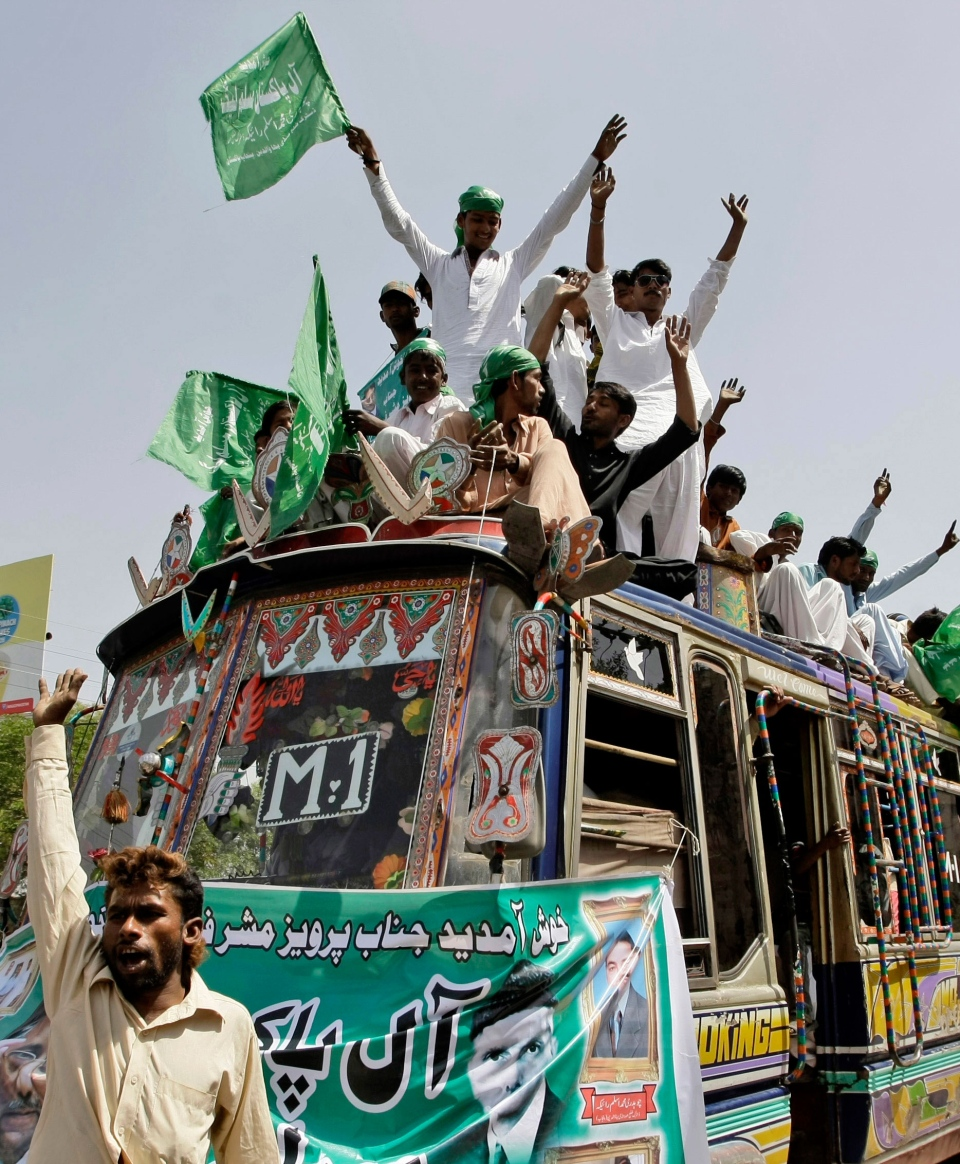 Supporters of former Pakistani President Pervez Musharraf, chant slogans while gathering outside Karachi airport, Pakistan, Sunday, March 24, 2013. (AP / Fareed Khan)