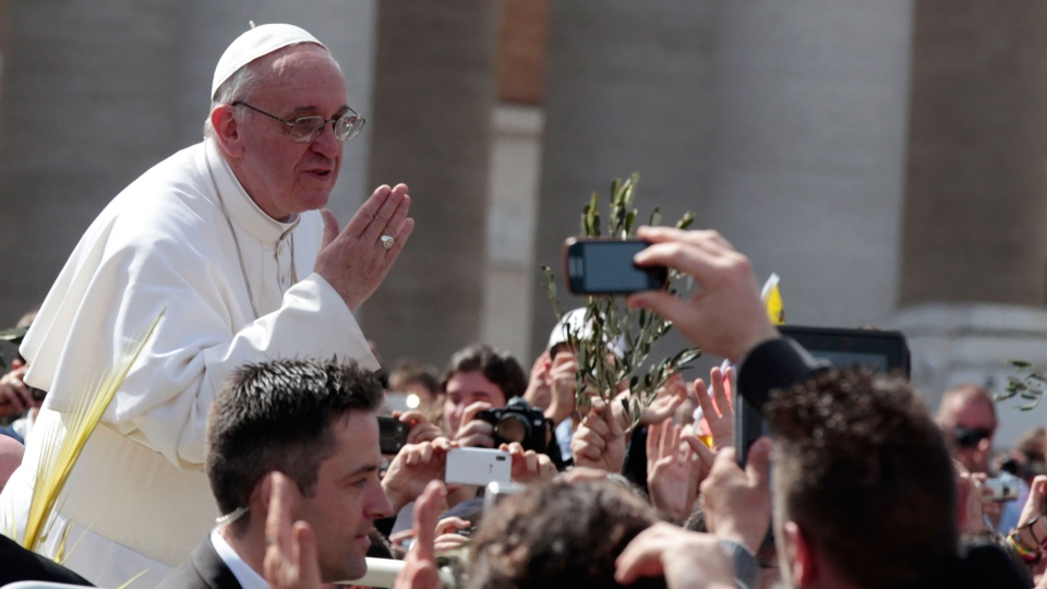 Pope Francis blows a kiss to faithful after celebrating his first Palm Sunday Mass in St. Peter's Square at the Vatican, Sunday, March 24, 2013. (AP / Gregorio Borgia)