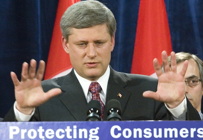 Prime Minister Stephen Harper gestures whiling announcing the changes at a news conference in Ottawa on Tuesday, April 8, 2008. (Fred Chartrand / THE CANADIAN PRESS)