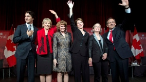 Justin Trudeau, Joyce Murray, Karen McCrimmon, Martha Hall Findlay, Deborah Coyne and Martin Cauchon are applauded at the end of the Liberal party leadership debate in Montreal on Saturday, March 23, 2013. (Ryan Remiorz / THE CANADIAN PRESS)