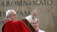 Pope Francis gives Palm Sunday Mass