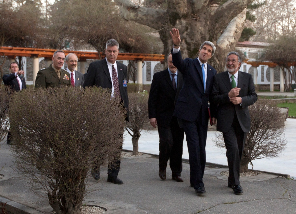 Secretary of State John Kerry, escorted by Afghan Foreign Minister Zalmai Rassoul, walks the grounds of the Presidential Palace in Kabul, Monday, March 25, 2013. (AP / Jason Reedl)