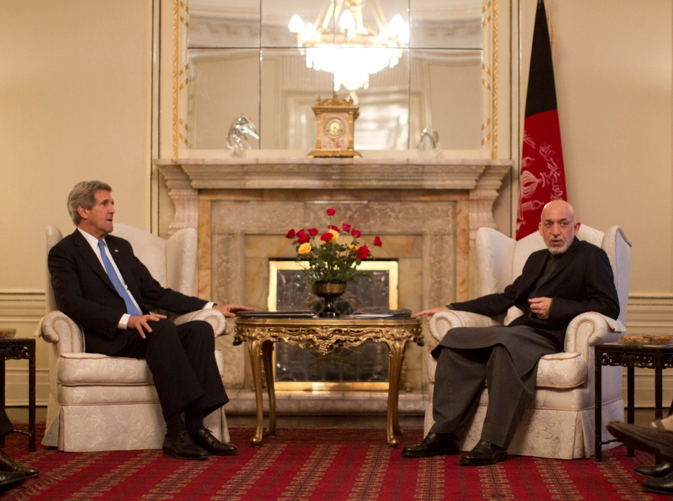 Secretary of State John Kerry meets with Afghan President Hamid Karzai at the Presidential Palace in Kabul, Monday, March 25, 2013. (AP / Jason Reed)