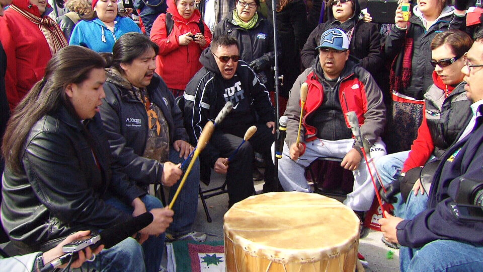 Supporters form a drum circle as 'Journey of Nishiyuu' walkers arrive at Parliament Hill in Ottawa, Monday, March 25, 2013.