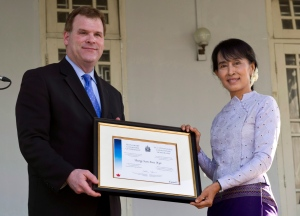 Nobel laureate Aung San Suu Kyi receives her honorary Canadian citizenship from the hands of Foreign Affairs Minister John Baird at her home in Yangon, Myanmar Thursday, March 8, 2012.  THE CANADIAN PRESS/Paul Chiasson