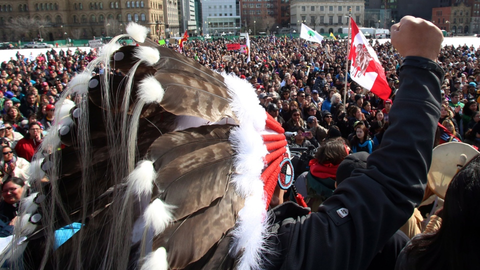 Hundreds of supporters gather on Parliament Hill, in support of a group of young aboriginal people who traveled 1,600 km on foot from the James Bay Cree community of Whapmagoostui, Quebec to Parliament Hill in Ottawa, Monday, March 25, 2013. (Fred Chartrand / THE CANADIAN PRESS)