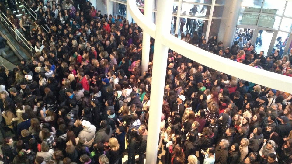 Rihanna fans wait in MTS Centre lobby for doors to open for March 25 concert