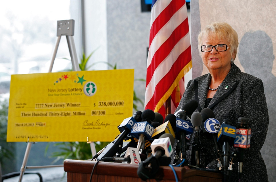 Carole Hedinger, Executive Director of the New Jersey Lottery, announces that the winning ticket in the $338 million Powerball was sold at Eagle Liquors in Passaic N.J., on Monday, March 25, 2013. (AP Photo/Rich Schultz)