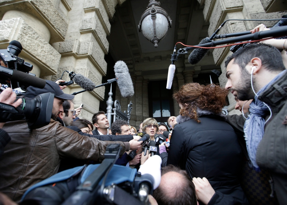 Giulia Bongiorno, lawyer of Amanda Knox's ex-boyfriend, Raffaele Sollecito, centre, talks to journalists as she leaves Italy's Court of Cassation, in Rome, Tuesday, March 26, 2013. (AP / Gregorio Borgia)