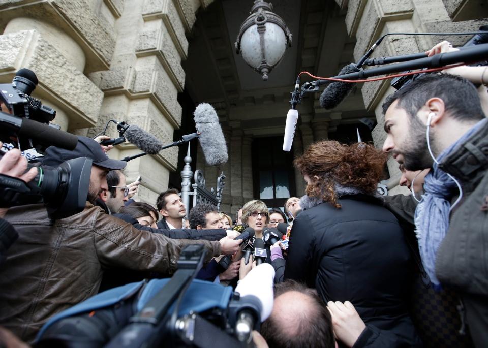 Giulia Bongiorno, lawyer of Amanda Knox's ex-boyfriend, Raffaele Sollecito, centre, talks to journalists as she leaves Italy's Court of Cassation, in Rome, Tuesday, March 26, 2013. (AP / Gregorio Borgia)