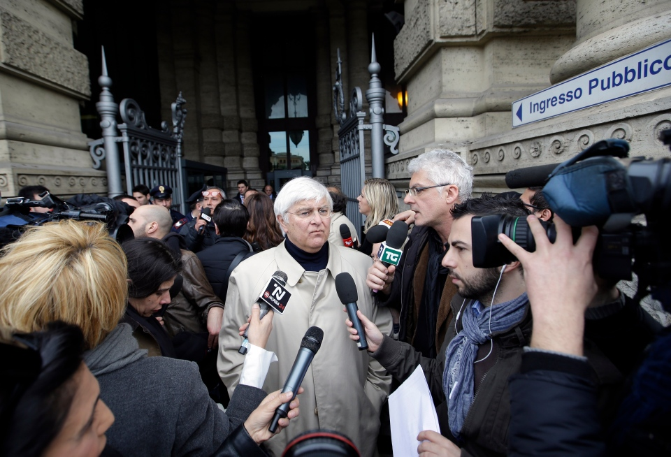 Luciano Ghirga, lawyer of Amanda Knox, centre, talks to journalists as he leaves Italy's Court of Cassation, in Rome, Tuesday, March 26, 2013. (AP / Gregorio Borgia)