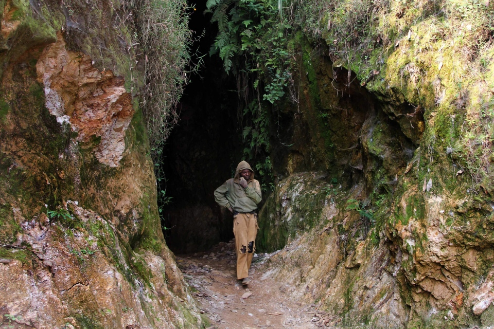 A miner walks out of a once-lucrative cassiterite mining shaft in eastern Congo in this August 2012 file photo. (AP Photo/Marc Hofer)