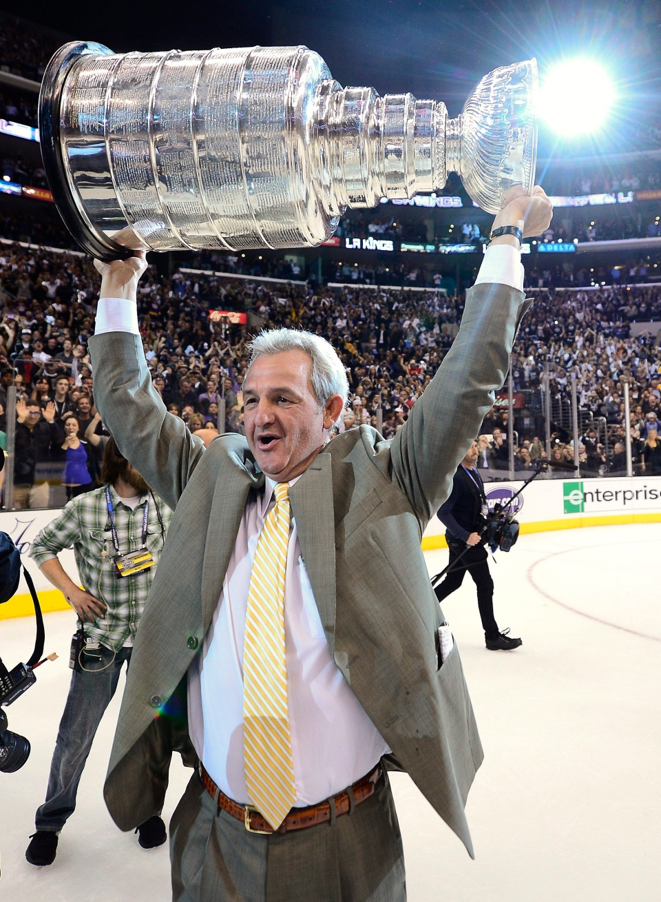 Kings coach Darryl Sutter hoists the Stanley Cup after beating the New Jersey Devils during Game 6 of the NHL hockey Stanley Cup finals, Monday, June 11, 2012, in Los Angeles. Sutter will be meeting with President Barack Obama Mar.  26, 2013. (AP / Mark J. Terrill)