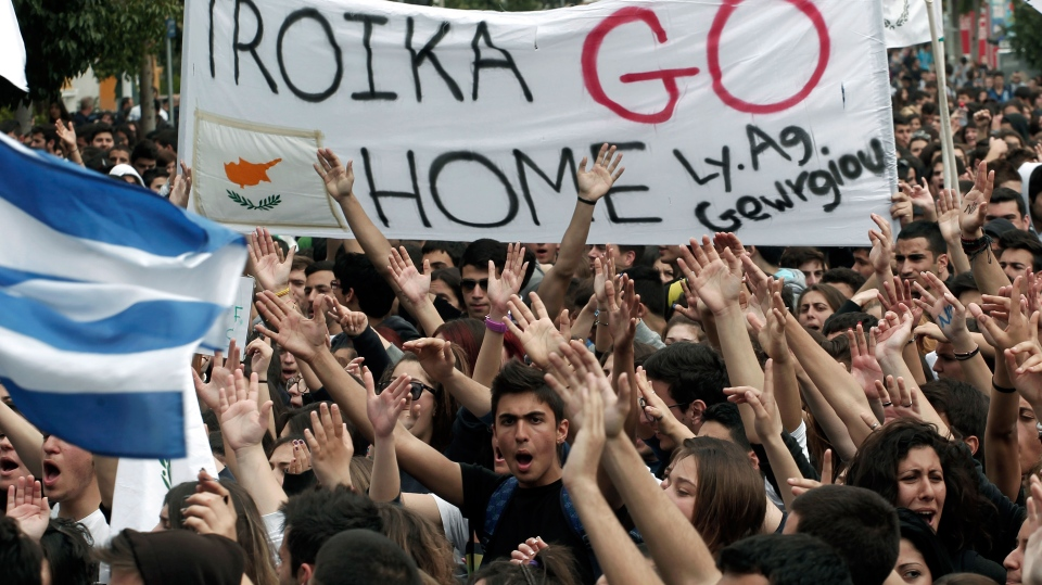 Cypriot students shout slogans near the presidential palace in capital Nicosia, on Tuesday, March 26, 2013. (AP / Petros Giannakouris)