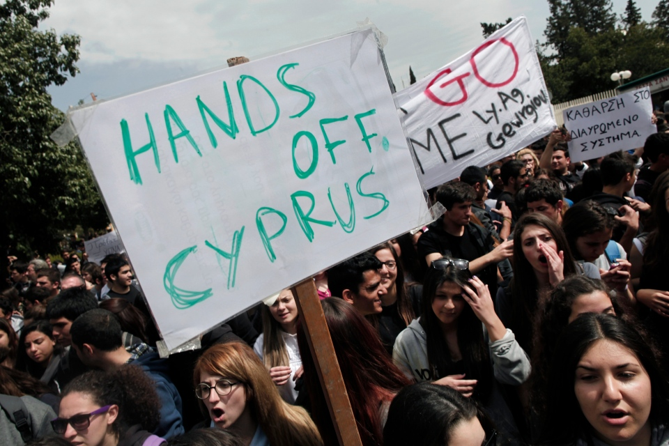 Cypriot students shout slogans during a protest against the bailout package outside the presidential palace in capital Nicosia, on Tuesday, March 26, 2013. (AP / Petros Giannakouris)