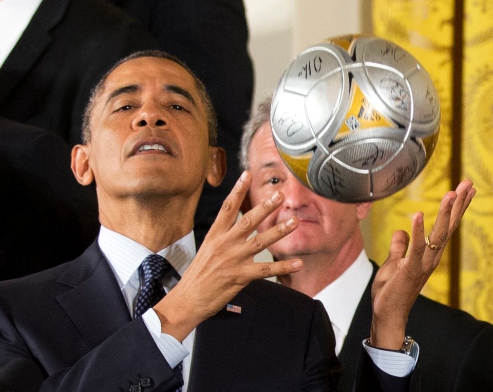 Los Angeles Kings hockey coach Darryl Sutter, right, watches as U.S. President Barack Obama catches the soccer ball after bouncing it off his forehead during a ceremony in the East Room of the White House in Washington, Tuesday, March 26, 2013. (AP / Manuel Balce Ceneta)