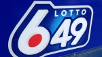 A sign outside a Toronto convenience store advertises a Lotto 6/49 draw. (Chris Kitching/CP24)