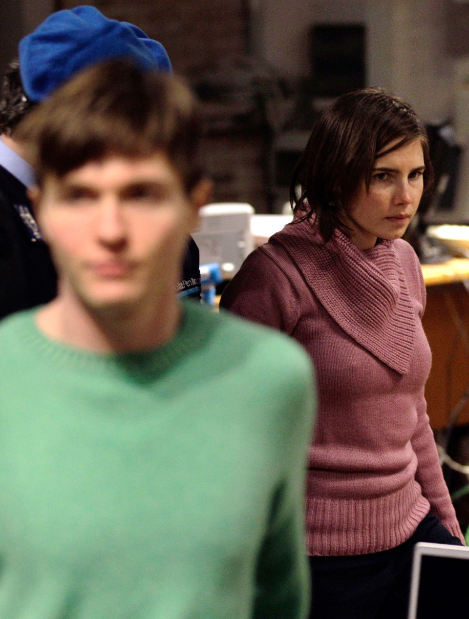 U.S. student Amanda Knox, right, walks past Raffaele Sollecito, as she arrives after a break to attend a hearing in her appeals trial, at Perugia's courthouse, Italy in this Saturday, Dec. 18, 2010 file photo.  (AP / Alessandra Tarantino)