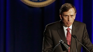 David H. Petraeus, former army general and head of the Central Intelligence Agency, speaks at the annual dinner for veterans and ROTC students at the University of Southern California, in downtown Los Angeles Tuesday, March 26, 2013. (AP / Reed Saxon)