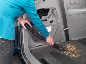 This product image provided by Honda Motor Co. shows the built-in vacuum cleaner featured on the 2014 Honda Odyssey Touring Elite. Honda Motor Co. showed off its updated Odyssey minivan Tuesday evening, March 26, 2013 ahead of the New York International Auto Show. (AP Photo/Honda Motor Co.)