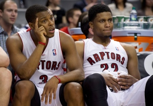 Toronto Raptors forward Rudy Gay (22) and guard Kyle Lowry (3) sit on the bench in the dying seconds of the loss to the Atlanta Hawks in NBA action in Toronto on Wednesday, March 27, 2013. (The Canadian Press/Frank Gunn)