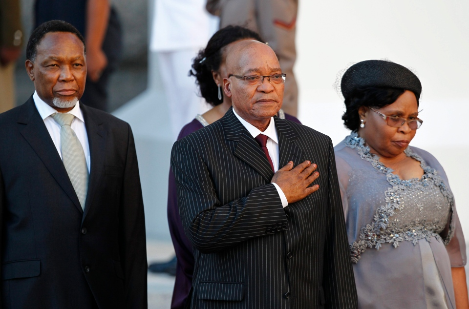 South African President Jacob Zuma, centre, during a guard of honor with his wife MaKhumalo Zuma, right, as Parliament open in Cape Town, South Africa, Thursday, Feb 9, 2012. (AP / Nic Bothma, Pool)