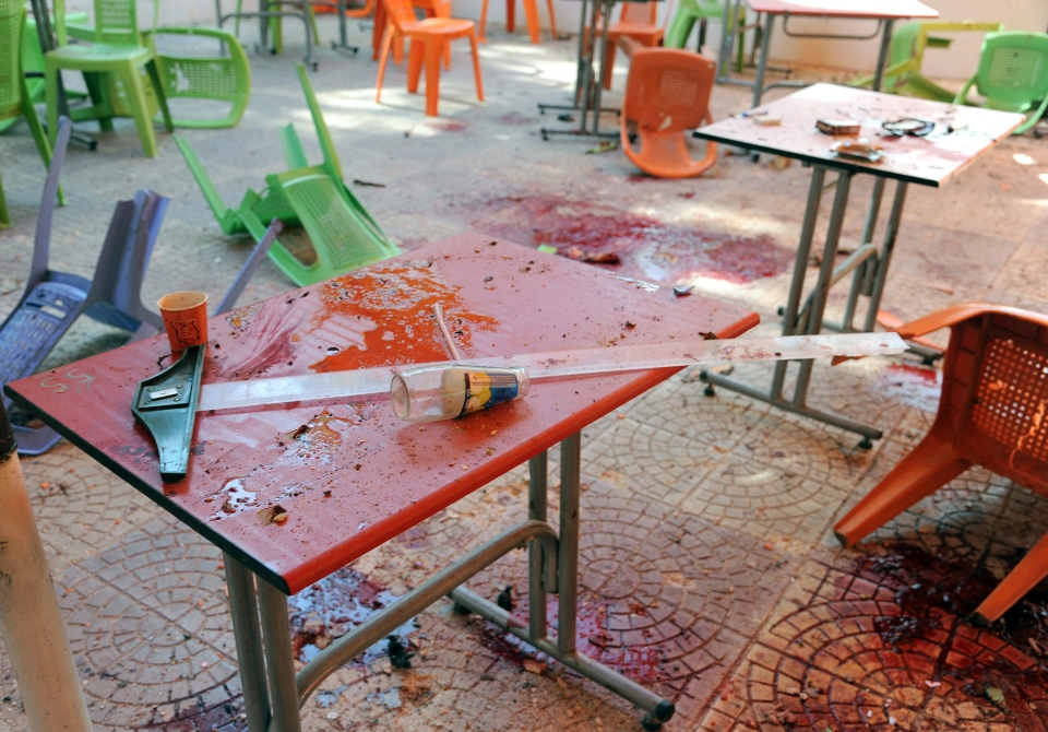 Plastic tables and chairs turned upside down are seen on the floor of the open-air cafeteria at Damascus University in the central Baramkeh district, in Damascus, Syria, Thursday, March 28, 2013. (SANA)