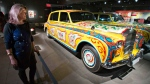 Deborah Tucker, who was at the only Beatles performance in Montreal in 1964, looks at John Lennon's psychedelic Rolls Royce at the Beatles exhibit at the Pointe-a-Calliere museum in Montreal on Thursday, March 28, 2013. (Ryan Remiorz / THE CANADIAN PRESS)