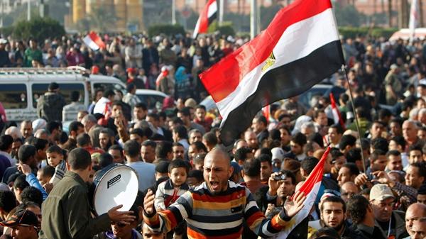 Anti-government protestors demonstrate in Tahrir Square in Cairo, Egypt, Sunday Feb. 13, 2011. (AP / Hussein Malla)