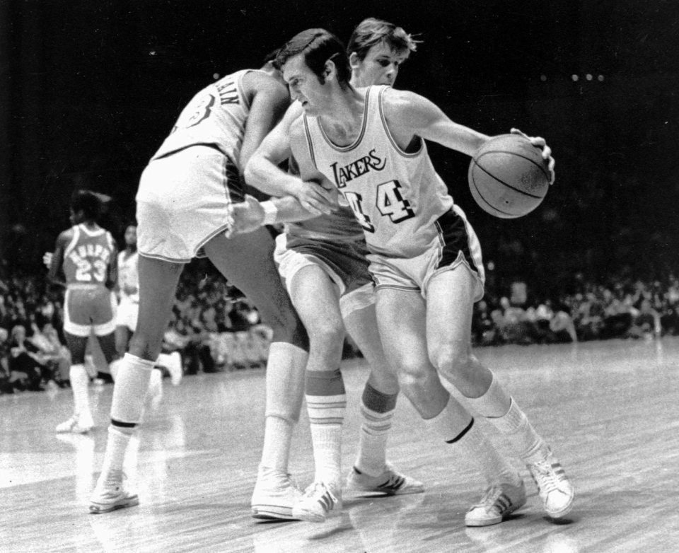 Los Angeles Lakers' Jerry West is fouled during a game against the Houston Rockets' John Vallely at the Forum in Inglewood, Calif., in this Dec. 27, 1971 file photo. The Lakers went on to their 28th straight win, beating the Rockets 137-115. (AP Photo, File)