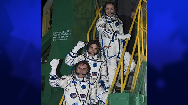 Russian Flight Engineer Alexander Misurkin, top, NASA Flight Engineer Chris Cassidy, and Soyuz Commander Pavel Vinogradov, bottom, wave farewell from the base of the Soyuz rocket at the Baikonur Cosmodrome in Baikonur, Kazakhstan, Friday, March 29, 2013. (NASA / Carla Cioffi)