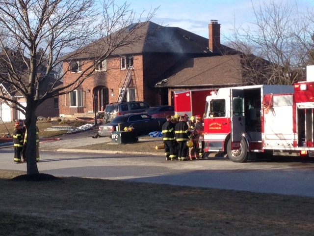 Emergency crews are shown outside an East Gwillimbury home that caught fire early Friday morning. York Regional Police say four people were seriously injured in the blaze. (Cam Woolley/CP24.com)