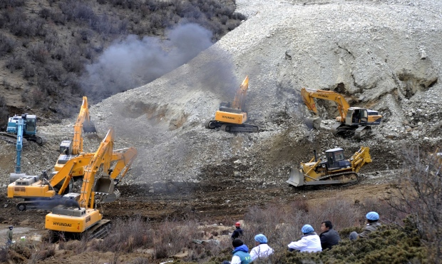 Workers at the scene of Tibet landslide