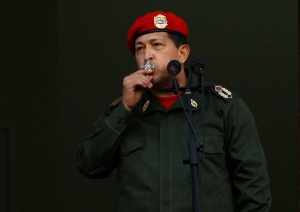 Former Venezuelan President Hugo Chavez kisses a crucifix as he greets supporters from a balcony in Miraflores presidential palace in this July 2011 file photo. (AP / Ariana Cubillos)