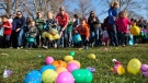 Children rush a field full of Easter Eggs, candy and other goodies Saturday March 30, 2013 during the Mix 106 Easter Egg Scramble at Julia Davis Park in Boise, Idaho. (AP / Idaho Statesman, Darin Oswald)