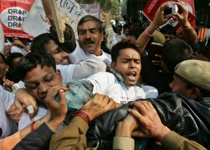 Indian police officers block demonstrators protesting against Swiss drugmaker Novartis AG's case against the Indian government on drug patents in New Delhi, India, Jan. 29, 2007. (AP / Saurabh Das)